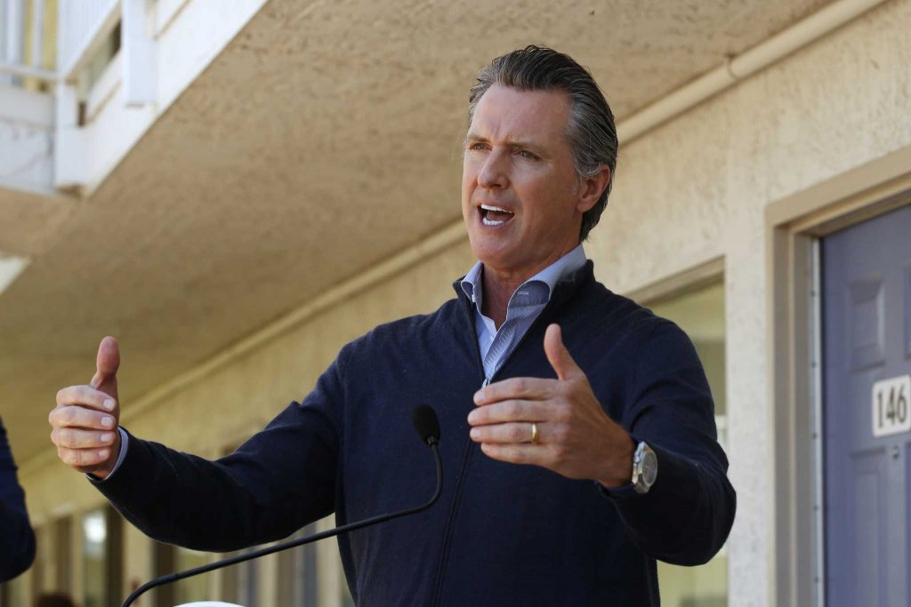 California governor rolls back more openings due to virus